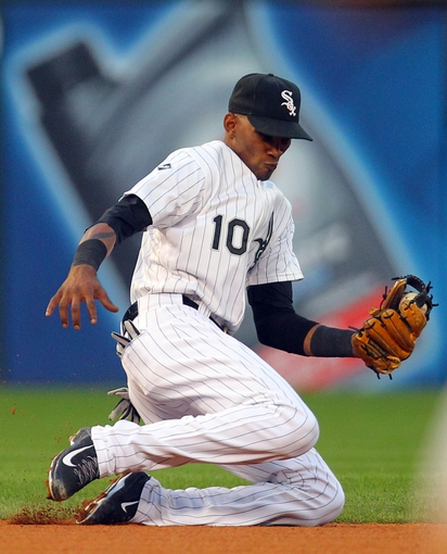 Aug 16, 2014; Chicago, IL, USA; Chicago White Sox shortstop Alexei Ramirez (10) fields a ground ball off the bat of Toronto Blue Jays first baseman Edwin Encarnacion (not pictured) during the sixth inning at U.S Cellular Field. Mandatory Credit: Dennis Wierzbicki-USA TODAY Sports
