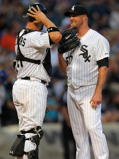 Aug 16, 2014; Chicago, IL, USA; Chicago White Sox catcher Tyler Flowers (left) and starting pitcher John Danks (right) talk on the mound during the sixth inning against the Toronto Blue Jays at U.S Cellular Field. Mandatory Credit: Dennis Wierzbicki-USA TODAY Sports