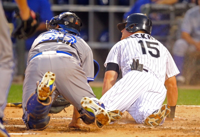 Aug 16, 2014; Chicago, IL, USA; Chicago White Sox second baseman Gordon Beckham (15) slides safe into home past the tag of Toronto Blue Jays catcher Dioner Navarro (30) during the sixth inning at U.S Cellular Field. Mandatory Credit: Dennis Wierzbicki-USA TODAY Sports