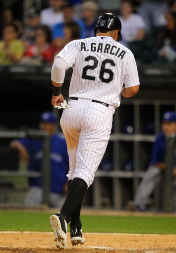 Aug 16, 2014; Chicago, IL, USA;Chicago White Sox right fielder Avisail Garcia (26) scores a run during the sixth inning against the Toronto Blue Jays at U.S Cellular Field. Mandatory Credit: Dennis Wierzbicki-USA TODAY Sports