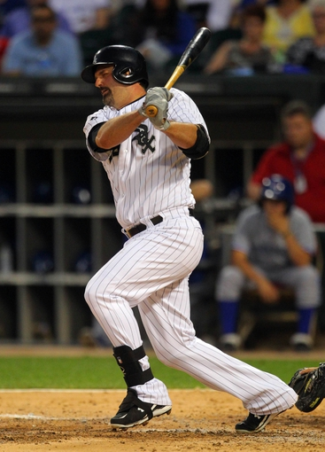 Aug 16, 2014; Chicago, IL, USA; Chicago White Sox designated hitter Paul Konerko (14) hits an RBI single during the sixth inning against the Toronto Blue Jays at U.S Cellular Field. Mandatory Credit: Dennis Wierzbicki-USA TODAY Sports