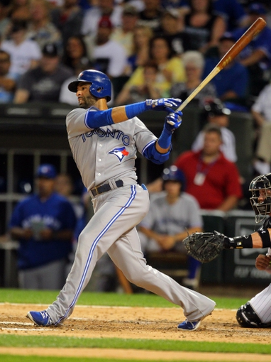 Aug 16, 2014; Chicago, IL, USA; Toronto Blue Jays right fielder Jose Bautista (19) hits an RBI single during the seventh inning against the Chicago White Sox at U.S Cellular Field. Mandatory Credit: Dennis Wierzbicki-USA TODAY Sports