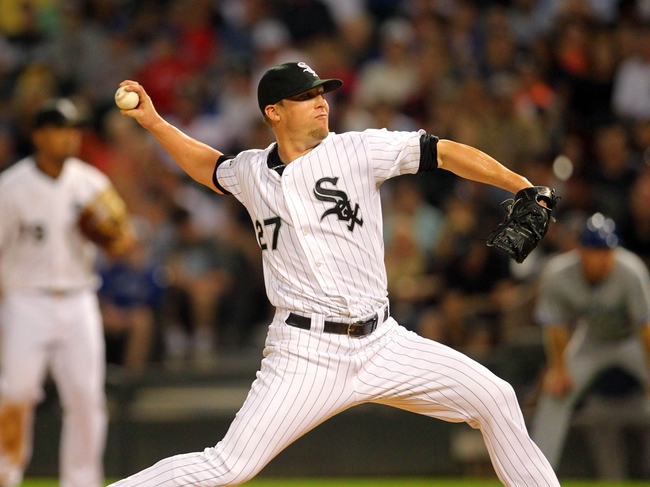 Aug 16, 2014; Chicago, IL, USA; Chicago White Sox relief pitcher Matt Lindstrom (27) delivers a pitch during the seventh inning against the Toronto Blue Jays at U.S Cellular Field. Mandatory Credit: Dennis Wierzbicki-USA TODAY Sports