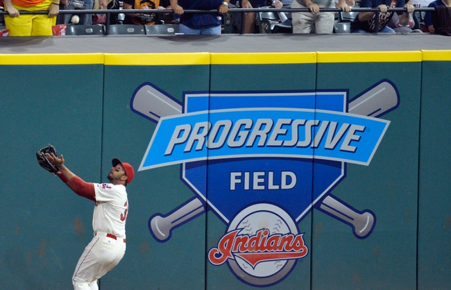Aug 16, 2014; Cleveland, OH, USA; Cleveland Indians right fielder Chris Dickerson (38) makes a running catch in the ninth inning against the Baltimore Orioles at Progressive Field. Mandatory Credit: David Richard-USA TODAY Sports