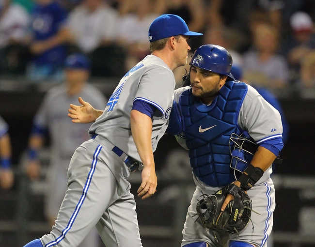 Aug 16, 2014; Chicago, IL, USA; Toronto Blue Jays relief pitcher Casey Janssen (left) and catcher Dioner Navarro (right) celebrate a victory after the last out of the ninth inning against the Chicago White Sox at U.S Cellular Field. Toronto won 6-3. Mandatory Credit: Dennis Wierzbicki-USA TODAY Sports