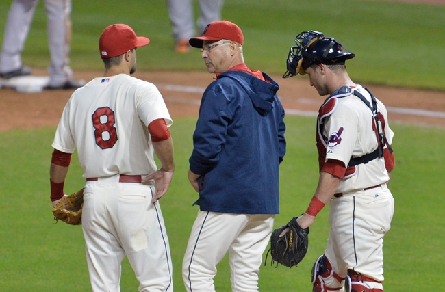 Aug 16, 2014; Cleveland, OH, USA; Cleveland Indians manager Terry Francona (center) stands on the mound with third baseman Lonnie Chisenhall (8) and catcher Yan Gomes (10) during a pitching change in the ninth inning against the Baltimore Orioles at Progressive Field. Mandatory Credit: David Richard-USA TODAY Sports