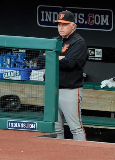 Aug 16, 2014; Cleveland, OH, USA; Baltimore Orioles manager Buck Showalter (26) watches from the dugout in the first inning against the Cleveland Indians at Progressive Field. Mandatory Credit: David Richard-USA TODAY Sports