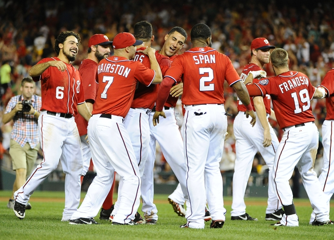 Aug 16, 2014; Washington, DC, USA; Washington Nationals catcher Wilson Ramos (40) celebrates with teammates after hitting a walk off RBI double against the Pittsburgh Pirates during the ninth at Nationals Park. The Nationals won 4-3. Mandatory Credit: Brad Mills-USA TODAY Sports