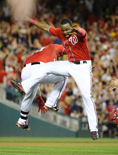 Aug 16, 2014; Washington, DC, USA; Washington Nationals catcher Wilson Ramos (40) celebrates with center fielder Denard Span (2) after hitting a walk off RBI double against the Pittsburgh Pirates at Nationals Park. The Nationals won 4-3. Mandatory Credit: Brad Mills-USA TODAY Sports