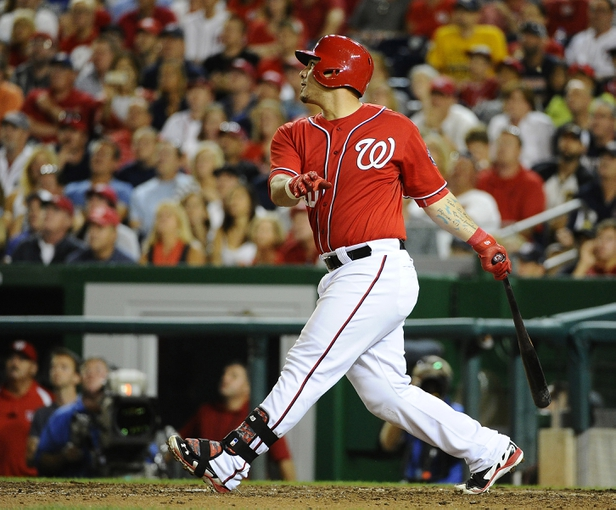 Aug 16, 2014; Washington, DC, USA; Washington Nationals catcher Wilson Ramos (40) hits a walk off RBI double against the Pittsburgh Pirates during the ninth at Nationals Park. The Nationals won 4-3. Mandatory Credit: Brad Mills-USA TODAY Sports