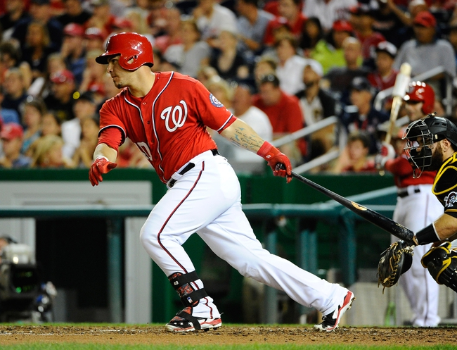 Aug 16, 2014; Washington, DC, USA; Washington Nationals catcher Wilson Ramos (40) hits a single against the Pittsburgh Pirates during the fifth inning at Nationals Park. The Nationals won 4-3. Mandatory Credit: Brad Mills-USA TODAY Sports