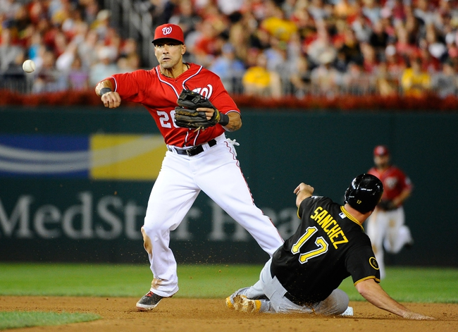 Aug 16, 2014; Washington, DC, USA; Washington Nationals shortstop Ian Desmond (20) forces out Pittsburgh Pirates first baseman Gaby Sanchez (17) and throws to first to complete a double play during the eighth inning at Nationals Park. The Nationals won 4-3. Mandatory Credit: Brad Mills-USA TODAY Sports
