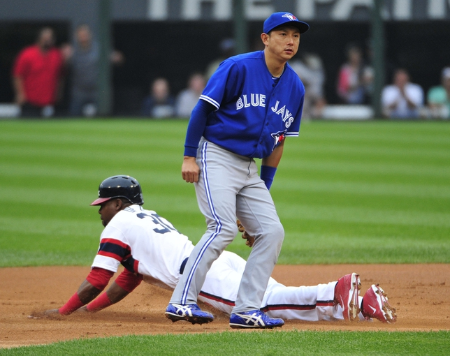 Aug 17, 2014; Chicago, IL, USA; Chicago White Sox left fielder Alejandro De Aza (30) slides safely into second base with a double as Toronto Blue Jays second baseman Munenori Kawasaki (66) waits for the throw during the first inning at U.S Cellular Field. Mandatory Credit: David Banks-USA TODAY Sports