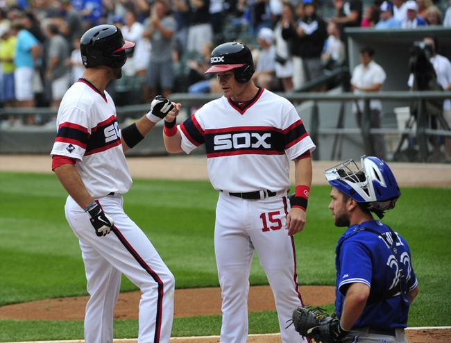 Aug 17, 2014; Chicago, IL, USA; Chicago White Sox center fielder Jordan Danks (20) is greeted by second baseman Gordon Beckham (15) after hitting a two-run homer against the Toronto Blue Jays during the first inning at U.S Cellular Field. Mandatory Credit: David Banks-USA TODAY Sports