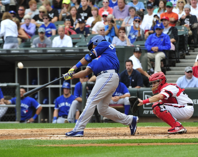 Aug 17, 2014; Chicago, IL, USA; Toronto Blue Jays designated hitter Edwin Encarnacion (10) hits a two-run homer against the Chicago White Sox during the fifth inning at U.S Cellular Field. Mandatory Credit: David Banks-USA TODAY Sports