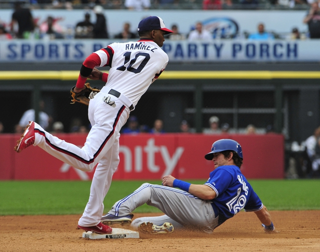 Aug 17, 2014; Chicago, IL, USA; Chicago White Sox shortstop Alexei Ramirez (10) forces out Toronto Blue Jays center fielder Colby Rasmus (28) during the fifth inning at U.S Cellular Field. Mandatory Credit: David Banks-USA TODAY Sports