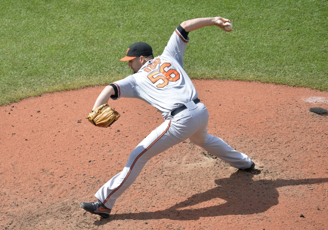 Aug 17, 2014; Cleveland, OH, USA; Baltimore Orioles relief pitcher Darren O'Day (56) delivers in the seventh inning against the Cleveland Indians at Progressive Field. Mandatory Credit: David Richard-USA TODAY Sports