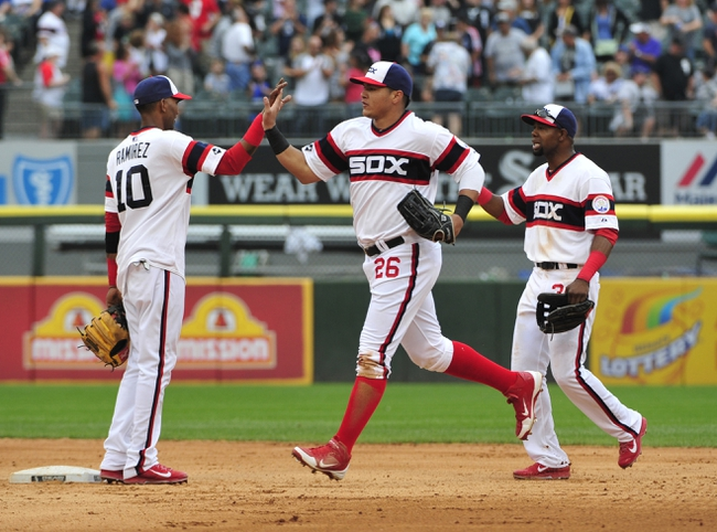 Aug 17, 2014; Chicago, IL, USA;  Chicago White Sox shortstop Alexei Ramirez (10)  right fielder Avisail Garcia (26) and  left fielder Alejandro De Aza (30)  celebrate their win against the Toronto Blue Jays at U.S Cellular Field. The Chicago White Sox defeated the Toronto Blue Jays 7-5. Mandatory Credit: David Banks-USA TODAY Sports