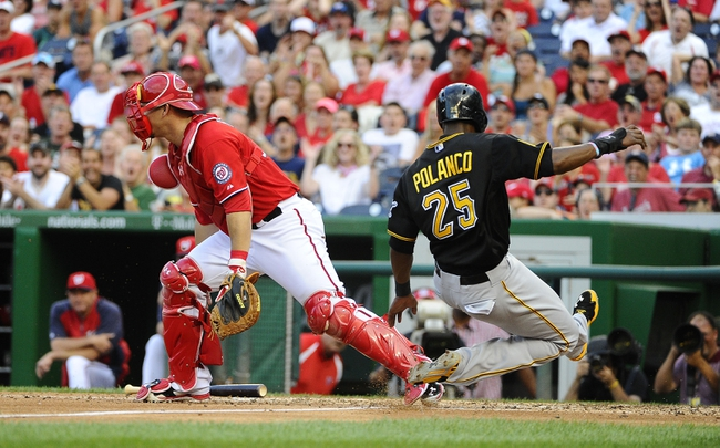 Aug 17, 2014; Washington, DC, USA; Pittsburgh Pirates right fielder Gregory Polanco (25) scores a run as Washington Nationals catcher Wilson Ramos (40) who can't hold on to the throw during the sixth inning at Nationals Park. Mandatory Credit: Brad Mills-USA TODAY Sports