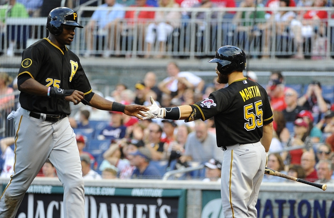 Aug 17, 2014; Washington, DC, USA; Pittsburgh Pirates right fielder Gregory Polanco (25) is congratulated by Pittsburgh Pirates catcher Russell Martin (55) after scoring a run against the Washington Nationals during the sixth inning at Nationals Park. Mandatory Credit: Brad Mills-USA TODAY Sports