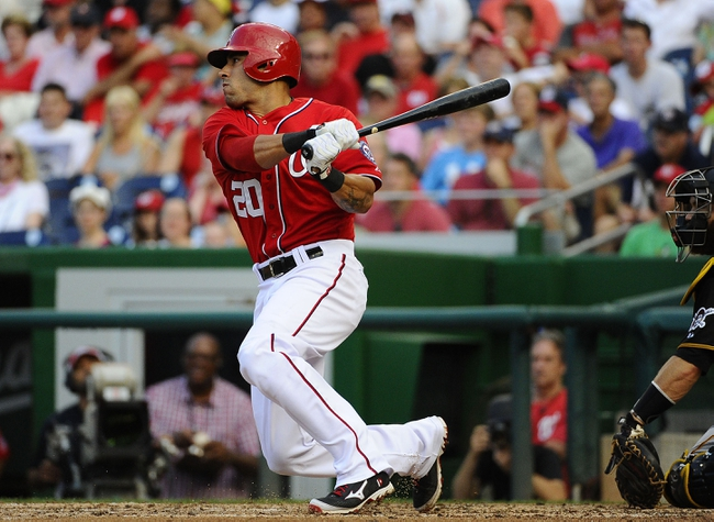 Aug 17, 2014; Washington, DC, USA; Washington Nationals shortstop Ian Desmond (20) hits an RBI single against the Pittsburgh Pirates during the sixth inning at Nationals Park. Mandatory Credit: Brad Mills-USA TODAY Sports
