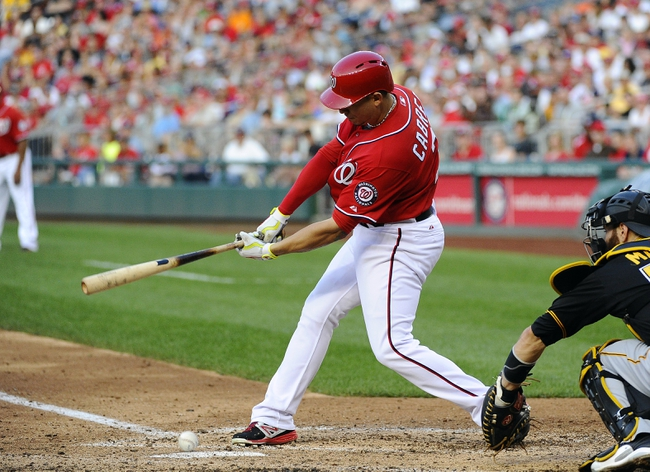 Aug 17, 2014; Washington, DC, USA; Washington Nationals second baseman Asdrubal Cabrera (3) grounds into a fielders choice against the Pittsburgh Pirates during the seventh inning at Nationals Park. The Nationals scored two runs on the play. Mandatory Credit: Brad Mills-USA TODAY Sports