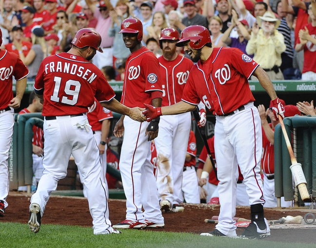 Aug 17, 2014; Washington, DC, USA; Washington Nationals left fielder Kevin Frandsen (19) is congratulated by third baseman Anthony Rendon (6) after scoring against the Pittsburgh Pirates during the seventh inning at Nationals Park. Mandatory Credit: Brad Mills-USA TODAY Sports