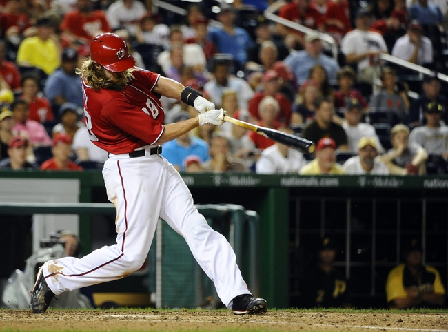 Aug 17, 2014; Washington, DC, USA; Washington Nationals right fielder Jayson Werth (28) hits a double against the Pittsburgh Pirates during the eleventh inning at Nationals Park. The Nationals won 6-5. Mandatory Credit: Brad Mills-USA TODAY Sports