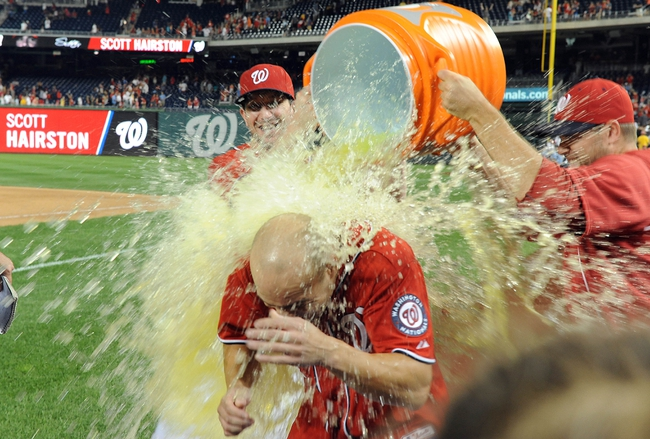 Aug 17, 2014; Washington, DC, USA; Washington Nationals left fielder Scott Hairston (7) is doused with Gatorade after hitting a walk off sacrifice fly against the Pittsburgh Pirates during the eleventh inning at Nationals Park. The Nationals won 6-5. Mandatory Credit: Brad Mills-USA TODAY Sports