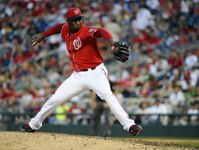 Aug 17, 2014; Washington, DC, USA; Washington Nationals relief pitcher Rafael Soriano (29) throws during the ninth inning against the Pittsburgh Pirates at Nationals Park. Mandatory Credit: Brad Mills-USA TODAY Sports