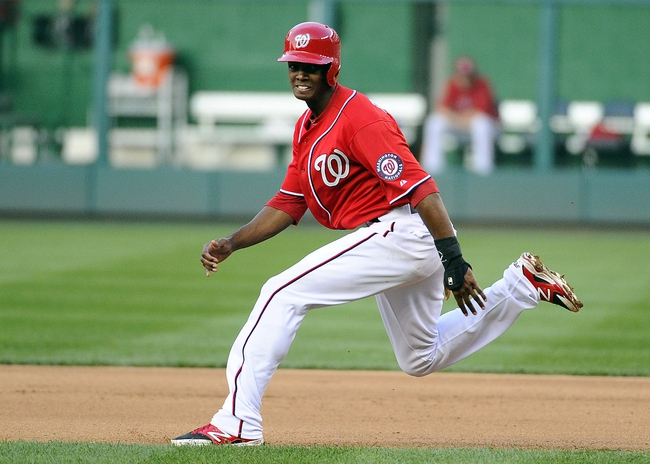 Aug 17, 2014; Washington, DC, USA; Washington Nationals right fielder Michael Taylor (18) runs to second base against the Pittsburgh Pirates during the seventh inning at Nationals Park. Mandatory Credit: Brad Mills-USA TODAY Sports