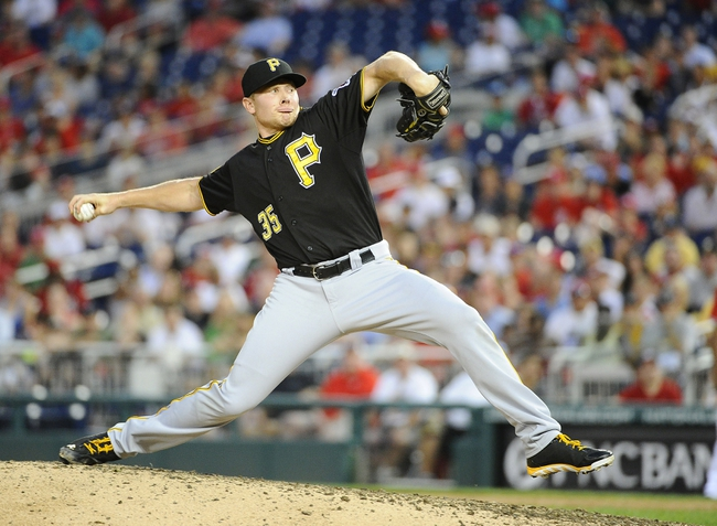 Aug 17, 2014; Washington, DC, USA; Pittsburgh Pirates relief pitcher Mark Melancon (35) throws during the ninth inning against the Washington Nationals at Nationals Park. Mandatory Credit: Brad Mills-USA TODAY Sports