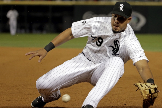 Aug 18, 2014; Chicago, IL, USA; Chicago White Sox first baseman Jose Abreu (79) fields the ball against the Baltimore Orioles during the fourth inning at U.S Cellular Field. Mandatory Credit: Jon Durr-USA TODAY Sports