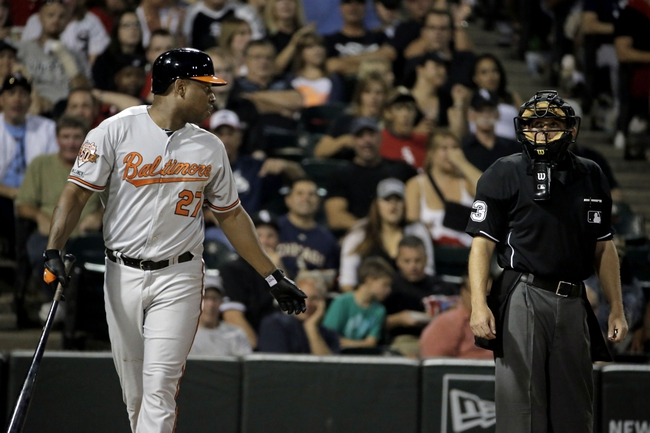 Aug 18, 2014; Chicago, IL, USA; Baltimore Orioles designated hitter Delmon Young (27) talks to umpire Hal Gibson (73) after striking out against Chicago White Sox right fielder Moises Sierra (not pictured) at U.S Cellular Field. Mandatory Credit: Jon Durr-USA TODAY Sports