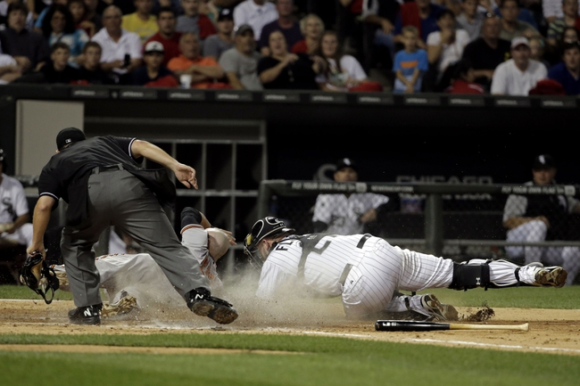 Aug 18, 2014; Chicago, IL, USA; Chicago White Sox catcher Tyler Flowers (21) tags out Baltimore Orioles left fielder Steve Pearce (28) at home plate during the fifth inning at U.S Cellular Field. Mandatory Credit: Jon Durr-USA TODAY Sports