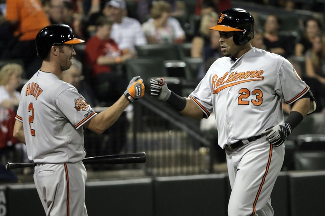 Aug 18, 2014; Chicago, IL, USA; Baltimore Orioles designated hitter Nelson Cruz (23) is congratulated by shortstop J.J. Hardy (2) after hitting a solo home run during the sixth inning at U.S Cellular Field. Mandatory Credit: Jon Durr-USA TODAY Sports
