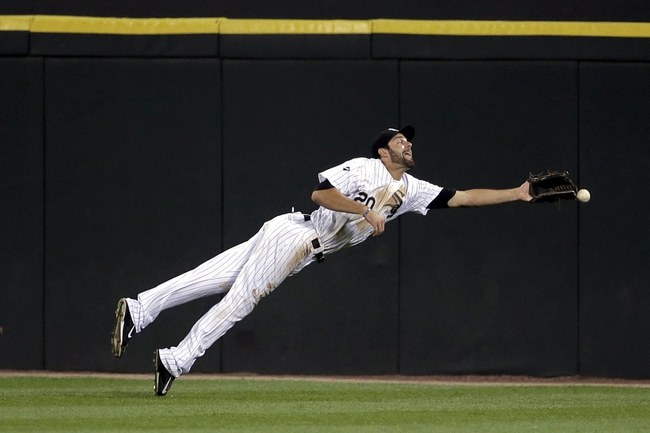 Aug 18, 2014; Chicago, IL, USA; Chicago White Sox center fielder Jordan Danks (20) fails to catch a ball hit by Baltimore Orioles left fielder Steve Pearce (not pictured) which resulted in an RBI double during the fifth inning at U.S Cellular Field. Mandatory Credit: Jon Durr-USA TODAY Sports