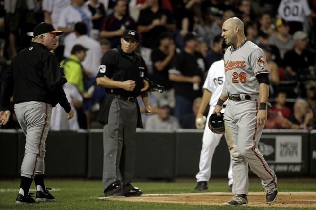 Aug 18, 2014; Chicago, IL, USA; Baltimore Orioles left fielder Steve Pearce (28) talks to Baltimore Orioles manager Buck Showalter (26) after being tagged out at home plate by Chicago White Sox catcher Tyler Flowers (not pictured) during the fifth inning at U.S Cellular Field. Mandatory Credit: Jon Durr-USA TODAY Sports