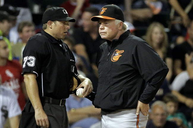 Aug 18, 2014; Chicago, IL, USA; Baltimore Orioles manager Buck Showalter (26) talks with umpire Hal Gibson (73) after left fielder Steve Pearce (not pictured) was tagged out at home plate by Chicago White Sox catcher Tyler Flowers (not pictured) at U.S Cellular Field. Mandatory Credit: Jon Durr-USA TODAY Sports