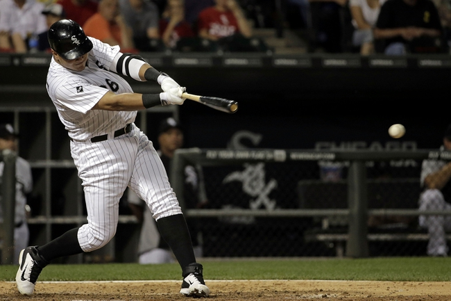 Aug 18, 2014; Chicago, IL, USA; Chicago White Sox right fielder Avisail Garcia (26) hits a 2-run RBI single against the Baltimore Orioles during the seventh inning at U.S Cellular Field. Mandatory Credit: Jon Durr-USA TODAY Sports