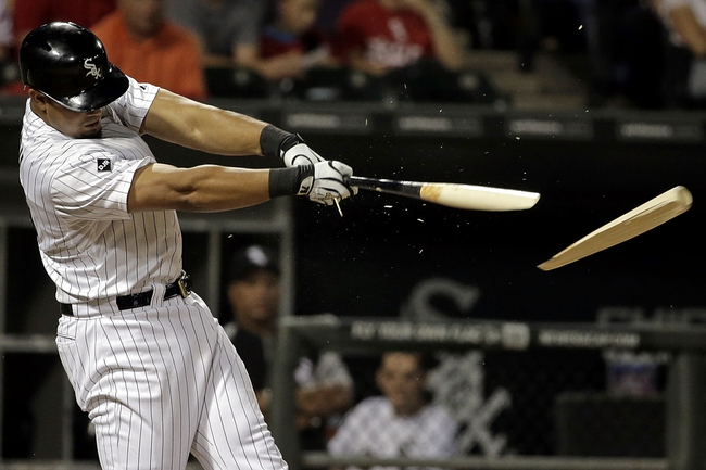 Aug 18, 2014; Chicago, IL, USA; Chicago White Sox first baseman Jose Abreu (79) breaks his bat and flies out against the Baltimore Orioles during the seventh inning at U.S Cellular Field. Mandatory Credit: Jon Durr-USA TODAY Sports
