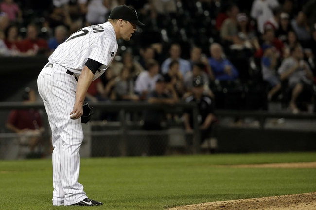 Aug 18, 2014; Chicago, IL, USA; Chicago White Sox relief pitcher Matt Lindstrom (27) reacts after giving up a 2-run home run against the Baltimore Orioles during the eighth inning at U.S Cellular Field. Mandatory Credit: Jon Durr-USA TODAY Sports