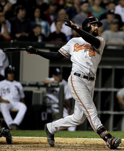 Aug 18, 2014; Chicago, IL, USA; Baltimore Orioles right fielder Nick Markakis (21) hits a 2-run home run against the Chicago White Sox during the eighth inning at U.S Cellular Field. Mandatory Credit: Jon Durr-USA TODAY Sports