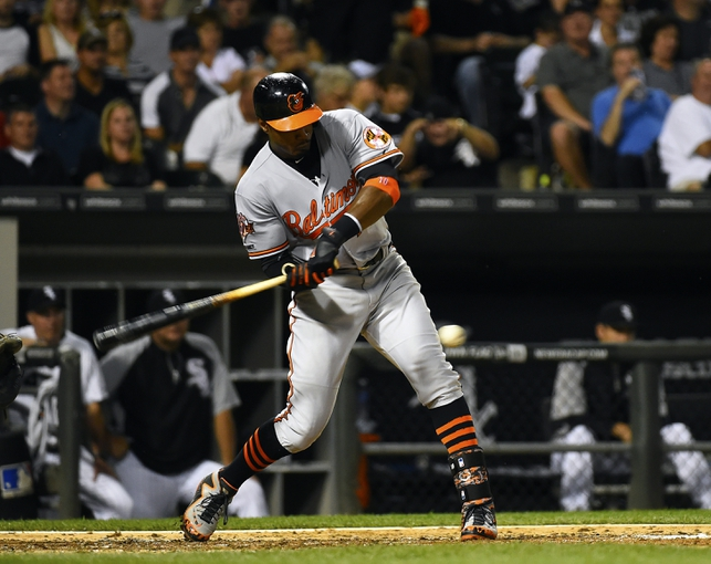 Aug 19, 2014; Chicago, IL, USA; Baltimore Orioles center fielder Adam Jones (10) hits a double against the Chicago White Sox during the sixth inning at U.S Cellular Field. Mandatory Credit: Mike DiNovo-USA TODAY Sports