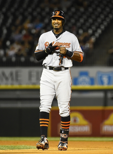 Aug 19, 2014; Chicago, IL, USA; Baltimore Orioles center fielder Adam Jones (10) reacts after hitting a double against the Chicago White Sox during the sixth inning at U.S Cellular Field. Mandatory Credit: Mike DiNovo-USA TODAY Sports