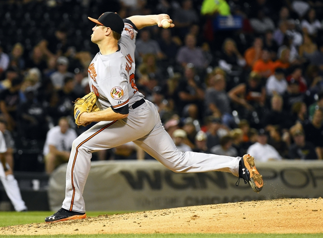 Aug 19, 2014; Chicago, IL, USA; Baltimore Orioles starting pitcher Chris Tillman (30) throws a pitch against the Chicago White Sox during the fifth inning at U.S Cellular Field. Mandatory Credit: Mike DiNovo-USA TODAY Sports