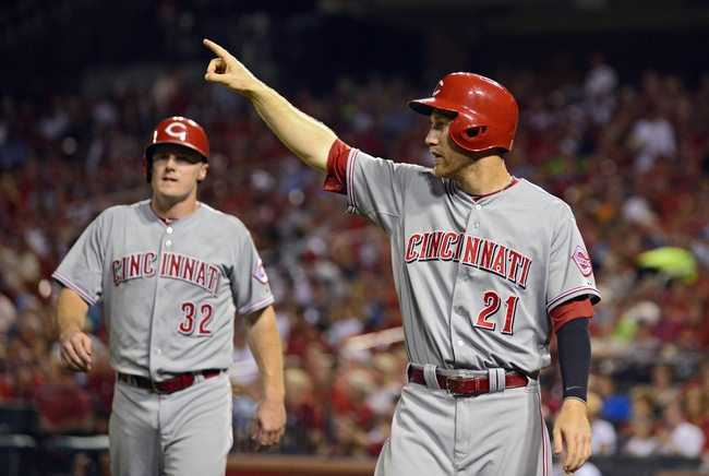 Aug 19, 2014; St. Louis, MO, USA; Cincinnati Reds third baseman Todd Frazier (21) points to left fielder Ryan Ludwick (not pictured) after scoring during the sixth inning against the St. Louis Cardinals at Busch Stadium. Mandatory Credit: Jeff Curry-USA TODAY Sports