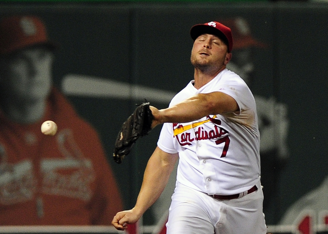 Aug 19, 2014; St. Louis, MO, USA; St. Louis Cardinals left fielder Matt Holliday (7) drops a fly ball hit by Cincinnati Reds right fielder Jay Bruce (not pictured) during the sixth inning at Busch Stadium. Mandatory Credit: Jeff Curry-USA TODAY Sports