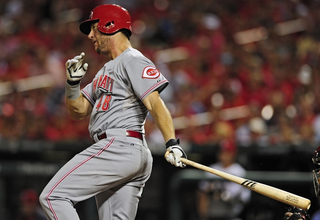 Aug 19, 2014; St. Louis, MO, USA; Cincinnati Reds left fielder Ryan Ludwick (48) hits a two run double off of St. Louis Cardinals starting pitcher John Lackey (not pictured) during the sixth inning at Busch Stadium. Mandatory Credit: Jeff Curry-USA TODAY Sports