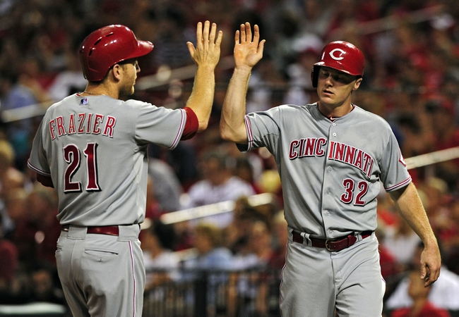 Aug 19, 2014; St. Louis, MO, USA; Cincinnati Reds right fielder Jay Bruce (32) high fives third baseman Todd Frazier (21) after they both scored on a two run double by left fielder Ryan Ludwick (not pictured) during the sixth inning against the St. Louis Cardinals at Busch Stadium. Mandatory Credit: Jeff Curry-USA TODAY Sports